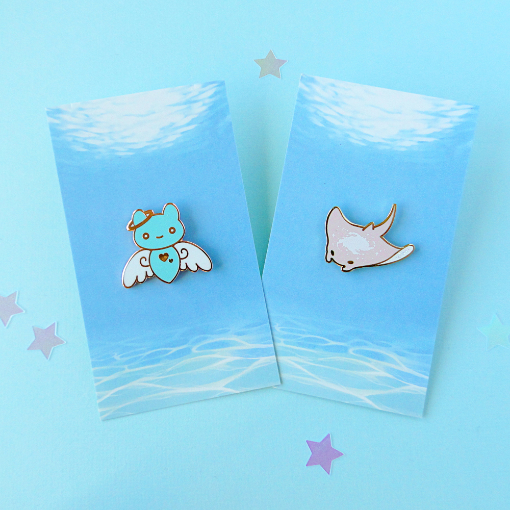 Pastel sea angel and manta ray pins